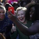 Hillary Clinton took a selfie with early voters Sunday at Chavis Community Center in Raleigh, N.C.