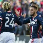 Oct 23, 2016; Foxborough, MA, USA; New England Revolution forward Diego Fagundez (14) is congratulated by midfielder Lee Nguyen (24) after he scored against the Montreal Impact during the first half at Gillette Stadium. Mandatory Credit: Winslow Townson-USA TODAY Sports