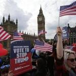 "Activists waved US flags as they ride on a ""Stop Trump"" battle bus as they approached the Houses of Parliament in London in September."