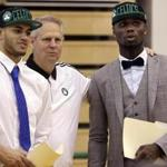 Danny Ainge, Boston Celtics president of basketball operations, talks with Celtics draft picks Abdel Nader, left, of Egypt, and Ben Bentil, of Ghana, right, after an introductory news conference Friday, June 24, 2016, in Waltham, Mass. (AP Photo/Elise Amendola)