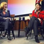 Governor Maggie Hassan of New Hampshire and incumbent US Senator Kelly Ayotte shared a laugh Tuesday while speaking with business leaders in Manchester, N.H.