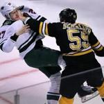 10/25/16: Boston, MA: The Bruins Tim Schaller (59,right) got the best of Minnesota's Zac Dalpe (27,left) during this early first period fight, as he stood him up with his left hand before knocking him to the ice with his right hand. The Boston Bruins hosted the Minnesota Wild in a regular season NHL hockey game at the TD Garden. (Globe Staff Photo/Jim Davis) section: sports topic: Bruins-Wild