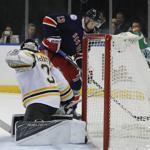 New York Rangers center Kevin Hayes (13) gets the puck past Boston Bruins goalie Zane McIntyre (31) to score during the second period of an NHL hockey game, Wednesday, Oct. 26, 2016, in New York. (AP Photo/Julie Jacobson)