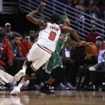 Chicago Bulls' Rajon Rondo (9) fights for a ball with Boston Celtics' Isaiah Thomas, right, during the first quarter of an NBA basketball game Thursday, Oct. 27, 2016, in Chicago. (AP Photo/Matt Marton)
