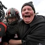 Former Woburn High football coach Rocky Nelson celebrates a 22-21 victory over Winchester in his final game on Thanksgiving Day in 2016.