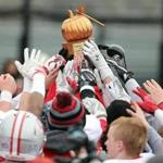 Boston MA 11/24/16 Catholic Memorial players reaching to touch the trophy after they defeated Boston College High during Thanksgiving Day football at Boston College High. (Photo by Matthew J. Lee/Globe staff) topic: 25bchigh reporter: