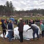 Bromfield students and other volunteers painted over the rock that was covered with hateful messages.