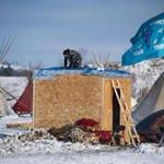 An activist built a shelter on the edge of the Standing Rock Sioux Reservation on Saturday.