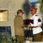 President Raul Castro of Cuba received his older brother's ashes from an honor guard in Santiago, Cuba, on Sunday.