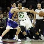 Boston Celtics' Al Horford, right, tries to get around Philadelphia 76ers' Ersan Ilyasova during the first half of an NBA basketball game, Saturday, Dec. 3, 2016, in Philadelphia. (AP Photo/Matt Slocum)