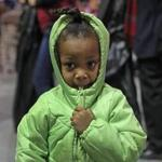 BOSTON, MA - 12/06/2016: Kaira Payne (cq) 4 yrs old with her new coat went shopping with her grandmother Mahogony Payne (cq) of Mattaphan. The Massachusetts Salvation Army will host its 17th annual Christmas Castle event to help thousands of local families in need at The Castle at Boston Park Plaza. The event makes the holiday season brighter for more than 12,000 Boston area family members who will have the opportunity to shop for warm coats and toys and receive a voucher for a warm Christmas dinner. The Christmas Castle also brings together nearly two dozen Boston area businesses and organizations and approximately 400 volunteers that help staff the event. (David L Ryan/Globe Staff Photo) SECTION: METRO TOPIC 07castle