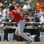 Boston Red Sox's Mauricio Dubon follows through on a swing against the Baltimore Orioles in a spring training baseball game, Saturday, March 26, 2016, in Sarasota, Fla. (AP Photo/Tony Gutierrez)