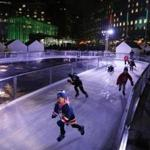 Young skaters take to the ice at the City Hall Plaza holiday site that opened on Wednesday, after a five-day delay due to mild weather.
