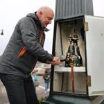 Dorchester-12/07/2016- Every week Jeffrey Gonyeau has to wind the clock that stands in Peabody Square in Dorchester. He has done this for more than a decade, using a hand crank to turn the old mechanism inside. John Tlumacki/Globe Staff (metro)