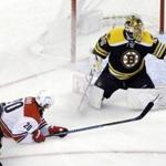 Boston Bruins goalie Anton Khudobin (35) makes a glove save against a shot by Carolina Hurricanes right wing Sebastian Aho (20) as Boston Bruins defenseman Kevan Miller (86) defends in the third period of an NHL hockey game, Thursday, Dec. 1, 2016, in Boston. (AP Photo/Elise Amendola)