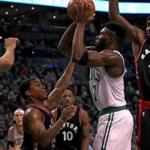 Boston, MA - 12/09/2016 - (2nd quarter) Boston Celtics forward Jaylen Brown (7) finds his lane blocked by a host of Toronto Raptors. as he pulls up for a shot during the second quarter. Celtics vs. Raptors at TD Garden. - (Barry Chin/Globe Staff), Section: Sports, Reporter: Adam Himmelsbach, Topic: 10Celtics-Raptors, LOID: 8.3.931477054.
