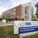 FILE - This Oct. 14, 2015, file photo shows the Food and Drug Administration campus in Silver Spring, Md. The FDA announced Monday, Dec. 12, 2016, that it denied the request by Swedish Match to remove several health warnings from its smokeless tobacco pouches, though regulators left open the possibility for other labeling changes it seeks. It's the first decision of its kind handed down by the agency since it gained authority to review the relative risks of tobacco products in 2009. (AP Photo/Andrew Harnik, File)