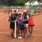 A group of Grand Slam Tennis Tours clients on the clay courts at the Tennis Club de Paris.