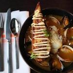 The golden cioppino at RFK Kitchen in Needham.