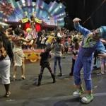 Ringling Bros. and Barnum & Bailey clowns dance with fans during a pre show for fans Saturday, Jan. 14, 2017, in Orlando, Fla. The Ringling Bros. and Barnum & Bailey Circus will end the
