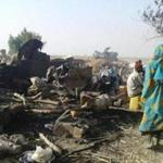 This handout image received courtesy of Doctors Without Border (MSF) on January 17, 2017, shows people standing next to destruction after an air force jet accidentally bombarded a camp for those displaced by Boko Haram Islamists, in Rann, northeast Nigeria. At least 52 aid workers and civilians were killed on January 17, 2017, when an air force jet accidentally bombed a camp in northeast Nigeria instead of Boko Haram militants, medical charity MSF said. / AFP PHOTO / Médecins sans Frontières (MSF) / Handout / RESTRICTED TO EDITORIAL USE - MANDATORY CREDIT