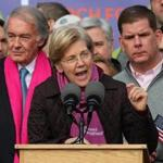 Boston-01/21/2017 Thousands of people filled Boston Common for the Boston Women's March for America. Sen. Elizabeth Warren speaks to the large crowd on Boston Common as Sen. Ed Markey(l) and Boston Mayor Marty Walsh stands behind her. John Tlumacki/Globe Staff(metro)