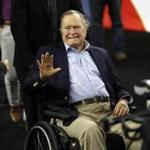 FILE - In this April 2, 2016, file photo, former President George H. W. Bush waves as he arrives at NRG Stadium before the NCAA Final Four tournament college basketball semifinal game between Villanova and Oklahoma in Houston. Houston-area media are quoting former President George H.W. Bush's chief of staff as saying that Bush has been hospitalized in Houston. (AP Photo/David J. Phillip, File)