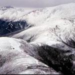 This is an ariel photo taken Tuesday, Feb. 27, 1996, of the Presidential Range in the White Mountains in New Hampshire with Mt. Eisenhower at lower left and Mt. Washington at upper right. About 25 Search and Rescue people are searching the area around Mt. Eisenhower for Nicholas Halpern, 50, of Lincoln, Mass., who never returned after a planned day hike to the top of Mt. Eisenhower. (AP Photo/Jim Cole)