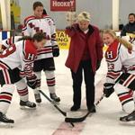 19sohingham - (center) Hingham High School principal Paula Girouard McCann dropping a puck. (handout)