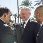 Defense Secretary Jim Mattis (center) spoke with the Iraqi defense minister on Monday in Baghdad. He told reporters that, contrary to Trump's statements, the United States is used to paying for its fuel.