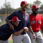 Fort Myers, FL - 2/18/2017 - Boston Red Sox outfielder Chris Young (30) has Boston Red Sox right fielder Mookie Betts (50) under his wing as they share a laugh following a drill on Saturday. Red Sox Spring Training. Day Six at Jet Blue Park in Fort Myers, FL. - (Barry Chin/Globe Staff), Section: Sports, Reporter: Peter Abraham, Topic: 19Red Sox, LOID: 8.3.1646383778.
