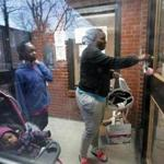 Boston, MA: 02-22-2017: Kyiesha Menzie arrives home at the Mildred C. Hailey Apartments, formerly known as Bromley-Heath, in the Jamaica Plain n neighborhood of Boston, Mass. Feb. 22, 2017. With her Is her daughter Summer Murrain (in carriage) and her son Jordan Cage (another son Joseph Murrain was there but can't be seenn). Photo/John Blanding, Boston Globe staff story/Evan Allen ( 23hailey )