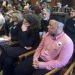 Kenzo Morris, right, listens during a public hearing on a bill that would bar discrimination based on gender identity on Tuesday in Concord, N.H.