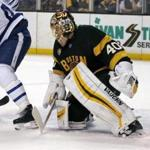 Boston Bruins goalie Tuukka Rask (40) looks to make a save through the legs of a Toronto Maple Leafs player during the first period of an NHL hockey game in Boston, Saturday, Feb. 4, 2017. (AP Photo/Mary Schwalm)