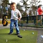 Milo Wilson, 3, from Kingston hit golf balls with his dad, Pete at Sandbaggers Driving Range in Pembroke on Saturday.