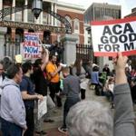 Health professionals joined a rally outside the State House to save the federal health law.