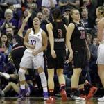 Washington's Kelsey Plum reacts after scoring against Utah in the second half of an NCAA college basketball game Saturday, Feb. 25, 2017, in Seattle. Plum scored 57 points and set the new all-time career NCAA scoring record of 3,397 points during the game. Washington won 84-77. (AP Photo/Elaine Thompson)