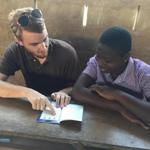 19zobella - Nick Bailey tutors a student in a Togolese village. (Bella English)
