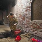 Boston, MA- March 17, 2017: City archeologist Joe Bagley excavates a unit during an archeological dig in the crypt of Old North Church in Boston, on March 17, 2017. Archeologists are digging in the centuries-old crypt of Old North Church, which wants to make the basement burial space accessible for public tours. (Globe staff photo / Craig F. Walker) section: metro reporter: