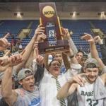 Babson's Joey Flannery (32), teammates and coach Stephen Brennan, center, celebrate after winning the NCAA Division III men's college basketball championship game against Augustana on Saturday, March 18, 2017, in Salem, Va. Babson won 79-78. (AP Photo/Don Petersen)