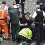 Foreign Office minister Tobias Ellwood (center) performed mouth-to-mouth resuscitation on the police officer who was stabbed and later died.
