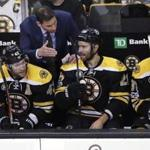 Boston Bruins head coach Bruce Cassidy talks with center Dominic Moore (28) during the first period of an NHL hockey game in Boston, Tuesday, March 21, 2017. (AP Photo/Charles Krupa)