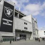 Two boys throw a football outside the Oakland Coliseum before the start of a rally to keep the Oakland Raiders from moving Saturday, March 25, 2017, in Oakland, Calif. NFL owners are expected to vote on the team's possible relocation to Las Vegas Monday or Tuesday at their meeting in Phoenix. (AP Photo/Eric Risberg)