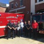 23zoblotter - Left to right: Firefighter-EMT Ryan York, Firefighter-Paramedic James Bateman, Hillary Sheridan, baby Henry Sheridan, Kevin Sheridan, Firefighter-EMT Jamie Clark, Firefighter-EMT Brian Dixon and Firefighter-Paramedic Carl Rizzo. (Amesbury Fire Rescue)