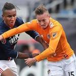 Foxborough MA 4/8/17 New England Revolution Juan Agudelo battles with Houston Dynamo Dylan Remick for control of the ball during second half action of their MLS game at Gillette Stadium. (Photo by Matthew J. Lee/Globe staff) topic: reporter:
