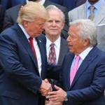 President Donald Trump shook hands with New England Patriots owner Robert Kraft during a ceremony to honor the Super Bowl LI winners at the White House.
