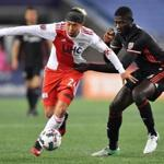 New England Revolution's Lee Nguyen, left, takes the ball upfield as D.C. United's Kofi Opare tries to slow him down in the first half at Gillette Stadium in Foxboro, Mass., Saturday, April 22, 2017. Gretchen Ertl for The Boston Globe.