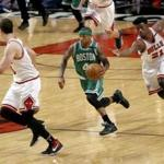 Boston Celtics' Isaiah Thomas (4) leads the fast break past Chicago Bulls' Jimmy Butler (21) and toward Paul Zipser during the second half in Game 4 of an NBA basketball first-round playoff series in Chicago, Sunday, April 23, 2017. (AP Photo/Charles Rex Arbogast)