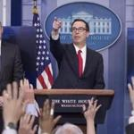 US Treasury Secretary Steven Mnuchin (right) and National Economic Director Gary Cohn (left) participatde in a news conference to discuss the tax reform plan on Wednesday.