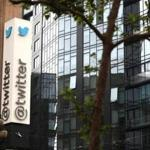 Twitter shares rose nearly 8 percent Wednesday on news that the service added users and revenue fell less than expected.